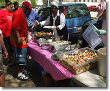 Sponsors of The Church in the Woods Services Serve Food to the Homeless