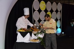 Chef Greg Lewis serves filet mignon to a guest at the Raleigh Chamber's May 2011 after hours event.