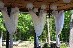 Billowing white curtains at Shady Wagon Farm's indoor-outdoor pavillion.